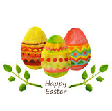 Three colorful watercolor Easter eggs and green leaves. Three colorful watercolor Easter eggs and leaves Stock Photos