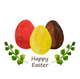Three colorful watercolor Easter eggs and green leaves. Three colorful watercolor Easter eggs and leaves Royalty Free Stock Images