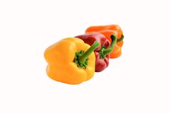 Three colorful whole bell peppers Stock Photo