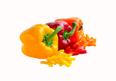 Three colorful whole and chopped bell peppers Stock Images