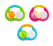 Three colorfull baby rattle - isolated on white Royalty Free Stock Images