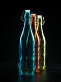 Three colorfull bottles Stock Image