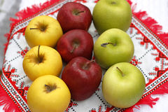 Three colors apples. Apples organized on a table in a traditional fashion. Illustration of rural life royalty free stock images