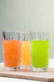 Three colors. drinks, soda. Three drinks on the wooden spacing Stock Images