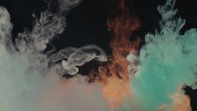 Three colors of ink dropped in water. Two colors of ink dropped into the water one by one, 4K stock footage