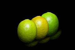 Three colors, lime on pure black background. Royalty Free Stock Photos
