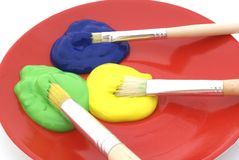 Three colors of paint. Three colors of poster paint stock photography