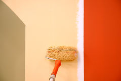 Three colors painting a wall Royalty Free Stock Photography