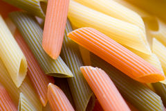 Three colors of pasta. Uncooked Stock Images