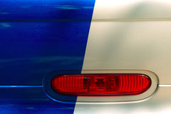 Three colors. Red blinker on blue dyed white car Stock Images