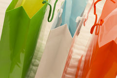Three colors shopping bags. Three brightly colored empty shopping bags Royalty Free Stock Photography