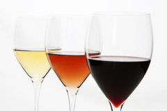 Three colors of wine. Red, rose and white. Stock Photos