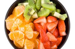 Three colour health, kiwi, tangerine and strawberries Royalty Free Stock Photography
