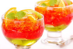 Three colour jelly with fruits Stock Images