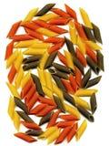 Three colour penne italian pasta. On white background Royalty Free Stock Photos