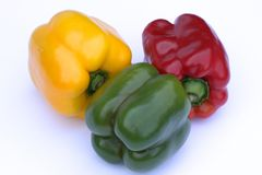 Three-colour pepper on a white background. Royalty Free Stock Photography
