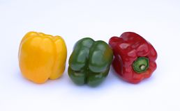 Three-colour pepper on a white background. Fresh three-colour pepper on a white background royalty free stock image