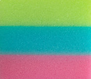 Three colour Sponges are stacking. Three colour Sponge stacking Green, Blue and Pink Royalty Free Stock Images