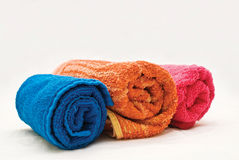 Three colour towels. On a white fabric Stock Images