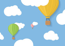 Three coloured aerostats in blue skies with clouds Royalty Free Stock Image