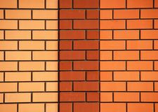 Three-coloured brick wall Stock Photos