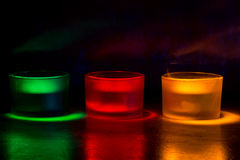Three coloured candles Stock Images
