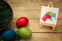 Three coloured eggs, canvas with blobs Royalty Free Stock Image