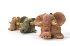 Three coloured marzipan elephants Stock Images
