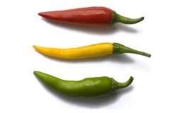 Three coloured peppers stock image