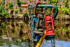 Three coloured petroleum lamps and a narrow boat royalty free stock photography