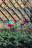 Three coloured pinwheels in a garden. Vintage effect Royalty Free Stock Photography