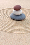Three coloured round pebbles zen garden Stock Photo