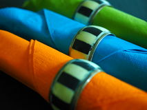 Three coloured serviettes in napkin rings Royalty Free Stock Image