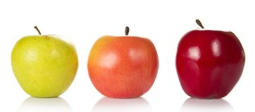 Three colourful apples of different grades Royalty Free Stock Photo