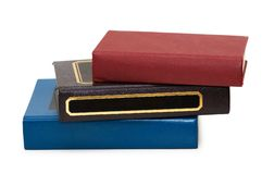 Three colourful books isolated on the white royalty free stock photos