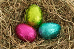 Three easter eggs nestled in straw Stock Photography
