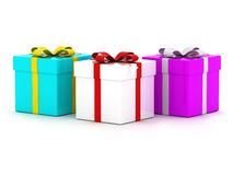 Three Colourful Gift Boxes. With ribbons. Isolated on white Stock Photos