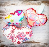 Three colourful hearts on vintage wood. Three colourful handmade hearts on a vintage retro wooden background Royalty Free Stock Photos