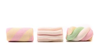Three colourful marshmallow. Close up. Royalty Free Stock Photos