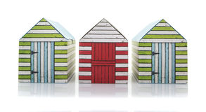 Three Colourful Retro Beach Huts Stock Images