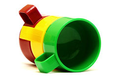 Three colourful tea cups Stock Photos