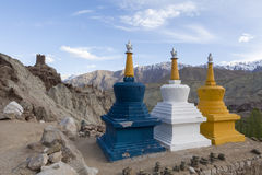 Three colourful tibetan buddhist religious stupas near a Buddhis Royalty Free Stock Image