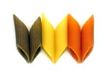 Three colours penne italian pasta. Three colour penne italian pasta on black background Royalty Free Stock Image