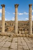 Three columns along the Roman road in Jerash Royalty Free Stock Image