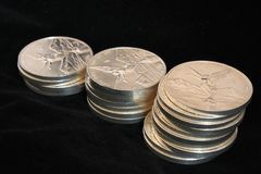 Three columns of silver coins Stock Images