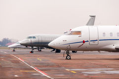 Three Commercial airplane, business jet or aircraft close up on airfield at airport Stock Photography