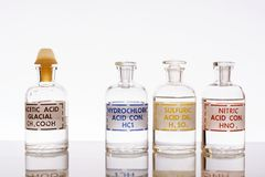 Three common mineral acids. The three common inorganic acids and the most common organic acid using in chemistry: hydrochloric, sulfuric, nitric and acetic stock photo