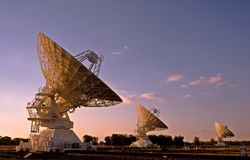 Three Compact Array Telescopes. Three radio telescopes photographed at sunset Royalty Free Stock Photo