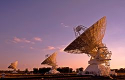 Three Compact Array Telescopes. Three radio telescopes photographed at sunset Royalty Free Stock Images