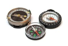 Three compasses. On white background Royalty Free Stock Photo